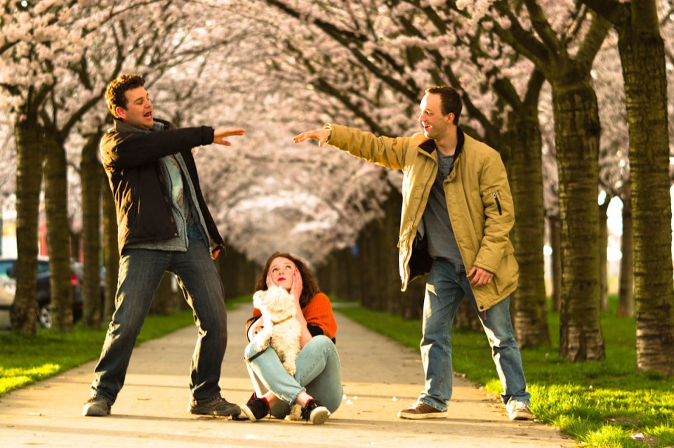 friends with girl waiting with dog under the japanese cherry blossoms