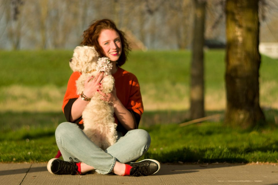beautiful brunette with her cute little dog mómo